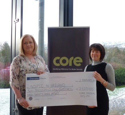 Patricia O'Hagan MBE, CEO of Core Systems presents cheque to Marie McGuckin, Corporate Fundraiser at NSPCC NI